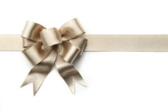 Gold ribbon with bow Stock Photography