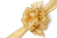 Gold ribbon with bow. Isolated on white Royalty Free Stock Photos