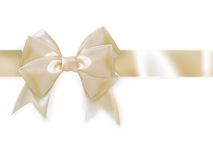 Gold ribbon with bow isolated on white. EPS 10 Stock Photography