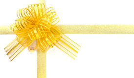 Gold ribbon bow knot on white Stock Image