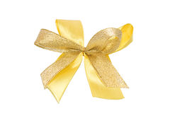 Gold ribbon bow for a present Royalty Free Stock Photo