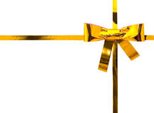 Gold ribbon with a bow on white Stock Photo