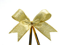 Gold ribbon with bow Royalty Free Stock Photo