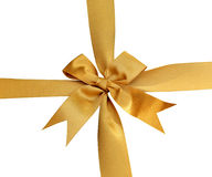 Gold ribbon with bow on white Royalty Free Stock Photo