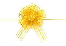 Gold ribbon bow on white Stock Photos