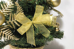 Gold ribbon on christmas tree Royalty Free Stock Photography