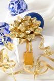 Gold ribbon gift Royalty Free Stock Photo