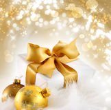 Gold ribbon gift with holiday background stock images