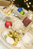 Gold ribbon gift on table Stock Photo