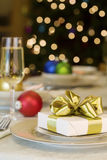 Gold ribbon gift on table Stock Photos