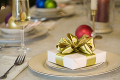 Gold ribbon gift on table Royalty Free Stock Photo