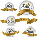 Gold ribbon glossy sale badges with various shape vector illustration