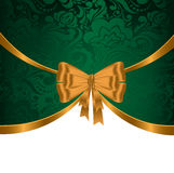Gold ribbon on green ornament Royalty Free Stock Photography