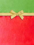 Gold ribbon on green and red  leather Royalty Free Stock Photography