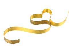 Gold ribbon heart. On white background royalty free stock photo