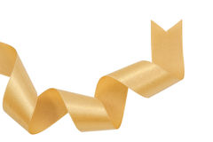 Gold ribbon nicely uncurled isolated Stock Photo
