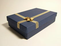 Gold ribbon over blue box - ornaments Stock Photo