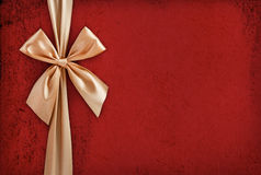 Gold ribbon on red background Stock Photo