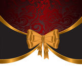 Gold ribbon on red ornament Royalty Free Stock Image
