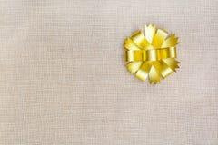 Gold ribbon on sackcloth Stock Photo