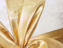 Gold ribbon wrapped Royalty Free Stock Images