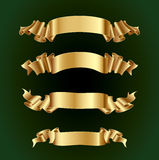 Gold ribbons Stock Images