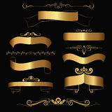 Gold ribbons and ornaments Stock Photos
