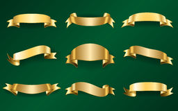 Gold ribbons set on green 1 Royalty Free Stock Images