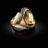 Gold ring. With a brilliants on a black background Royalty Free Stock Photography
