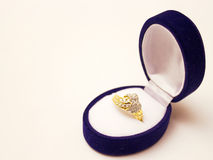 Gold ring. Beautiful gold ring with diamonds in decorative jewelry box,photography Stock Image