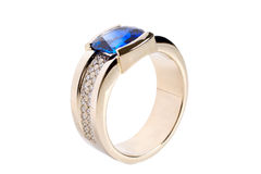 Gold ring. With dark blue sapphire Royalty Free Stock Photography