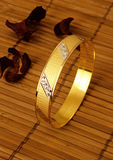 Gold ring. Embroidered golden ring on the cloth Stock Photo