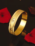 Gold ring. Embroidered golden ring on the cloth Stock Photography