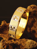 Gold ring. Embroidered golden ring on the cloth Royalty Free Stock Images