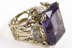 Gold ring with amethyst  Royalty Free Stock Image