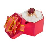 Gold ring with big ruby in gift packing Stock Photos