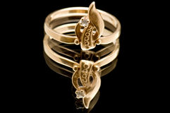 Gold ring on black Royalty Free Stock Photo