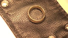 Gold Ring on Black Leather stock footage
