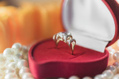 Gold ring with blue gem in a gift box Stock Photo