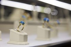 Gold ring with blue stone  Royalty Free Stock Image