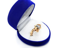 Gold ring with blue topaz Royalty Free Stock Photography