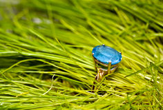 Gold ring with a blue topaz Stock Images
