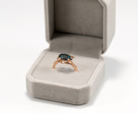 Gold ring with blue Topaz in a velvet gift box Stock Images