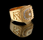 Gold ring with brilliant on black stock photos