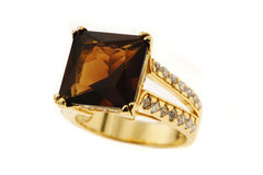 Ring with large stone. Gold ring with brown stone Royalty Free Stock Photo