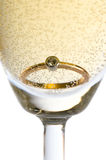 Gold ring in champagne. Close up Stock Photo