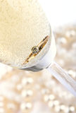 Gold ring in champagne. Close up Stock Images