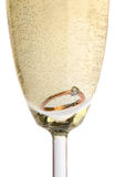 Gold ring in champagne. Close up Royalty Free Stock Image