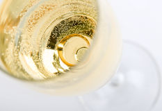 Gold ring in champagne. Close up Stock Image