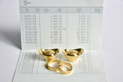 A gold ring and chinese money gold on bank saving account book Stock Images